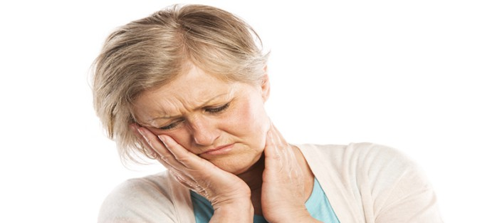 woman suffering from TMJ pain